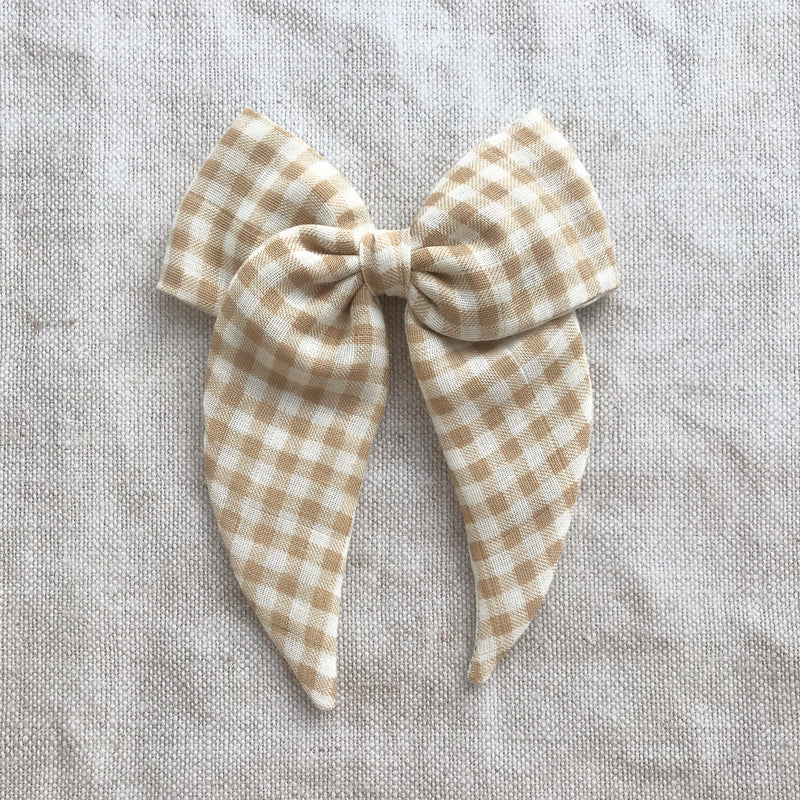 Little Love gingham cotton bow hair clips in biscuit and white for little girls, gingham check bow hair clips, gingham hair bow, gingham bow fabric hair clips, little love handmade hair bows, oversize gingham bow hair clip, girls hair bows, cotton praire bow, little love bows, beige gingham hair bow, brown gingham