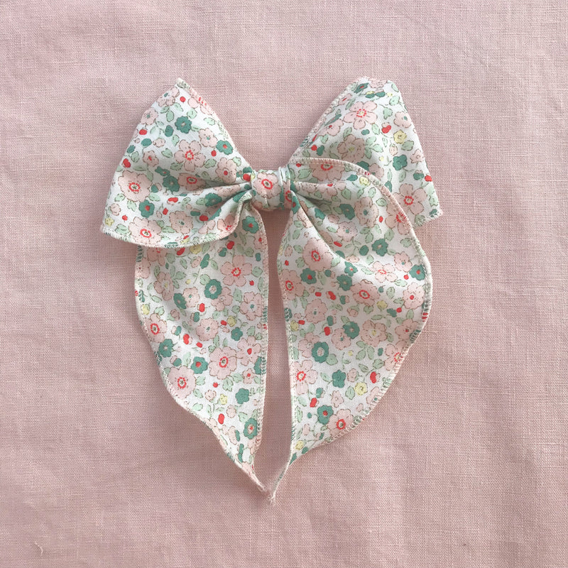 Little Love Eden mint green and pink floral print cotton bow hair clips for little girls, floral print cotton bow hair clips, pink flower print cotton floral hair bow, liberty  print bow fabric hair clips, little love handmade hair bows, oversize libertyfabric bow hair clips, girls hair bows, buy liberty cotton hair bows, Liberty bows UK, green liberty floral bow