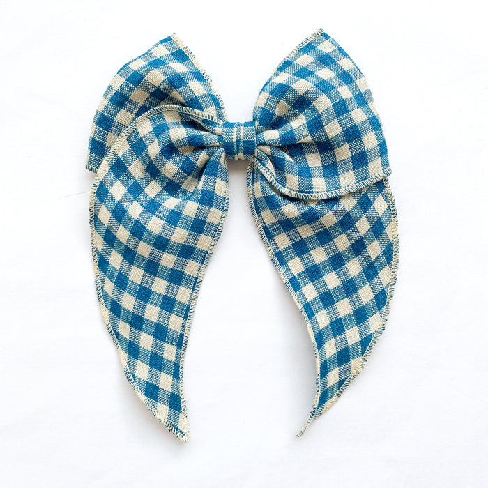 Little Love teal blue gingham linen bow hair clips for girls, gingham linen bow hair clips, blue gigham hair bow, blue linen hair bow, gingham linen hair bow,gingham handtied bow hair clip, little love handmade hair bows, oversize bow hair clips in gingham, girls blue check hair bows, handtied hair bows uk