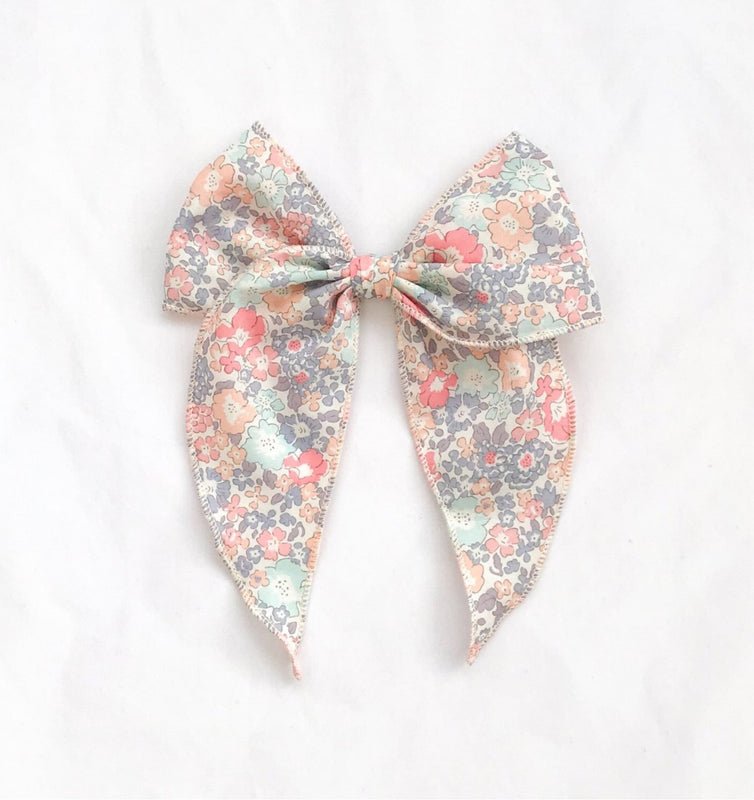 Little Love handmade hair bow clip in genuine Liberty London Tana Lawn Michelle fabric, Liberty hair accessories, Liberty London hair accessory, liberty floral bow, handmade hair bows in liberty fabric, tana lawn bows, liberty fabric hair clips, Michelle liberty print bows, bows in liberty print Michelle, pink floral liberty bows