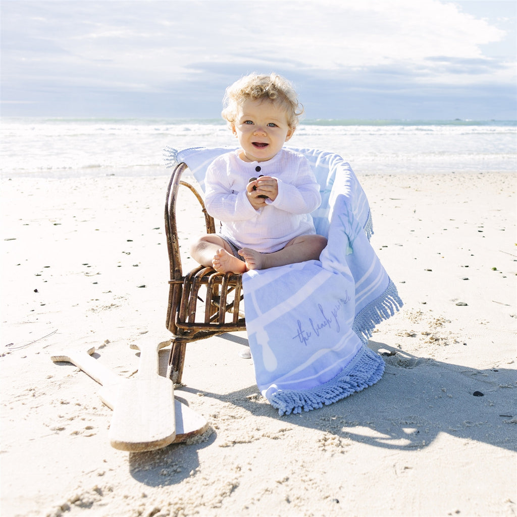 Children's beach captain roundie towel with blue ocean design | The Beach People