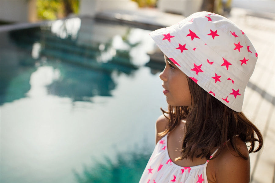 Girls cotton sun hat in a pop star print by sunuva