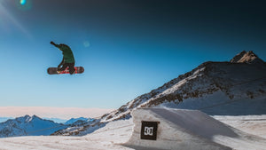 Snowboarder grab mid air.
