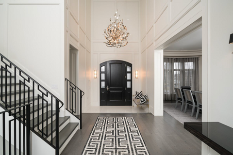 chandelier in stunning grey and neutral entrance hall