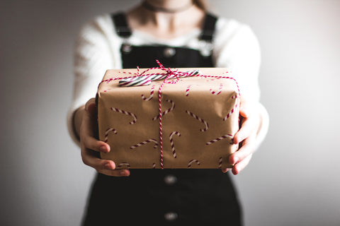 Person giving a Christmas gift