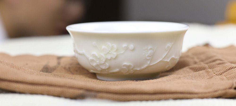 Ding Kiln Plum Blossom Carved Tea Cup