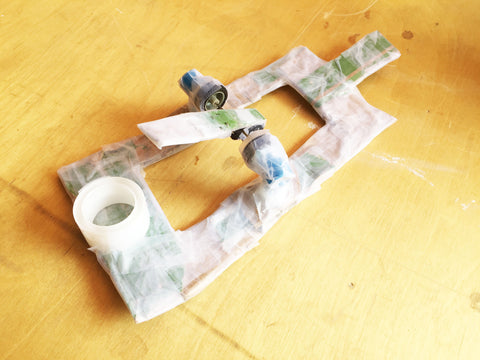 Image of the cardboard and tape paddle boat with a scrap wind-up motor built by my son