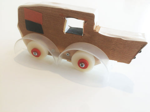Image of Toy Car that I helped my son build from his sketch, scrap wood and random hardware