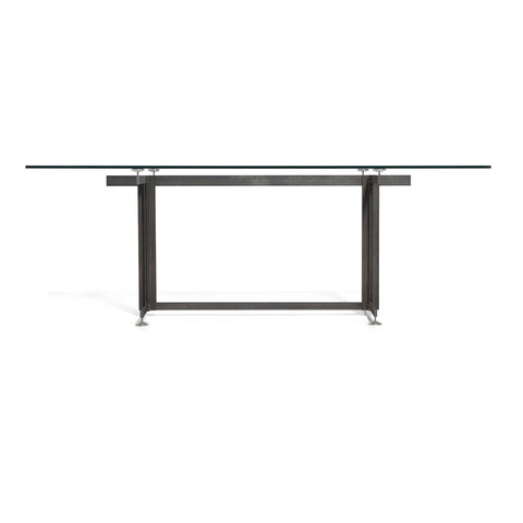 Broad view of the Eric Jacoby Tectonic Dining Table illustrating the way the glass floats above the steel frame