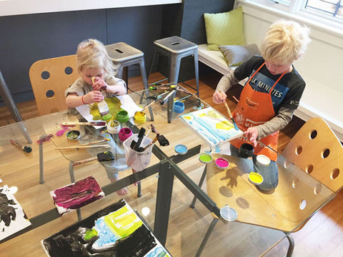 Image of two young children using colorful paints on the Eric Jacoby Design Tectonic Dining Table