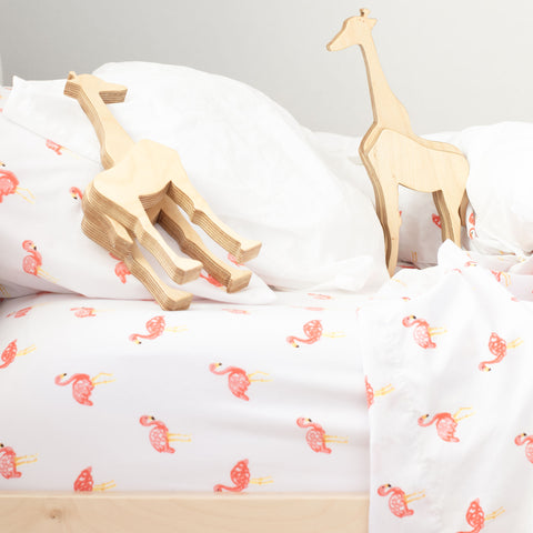baby wooden giraffes in bed