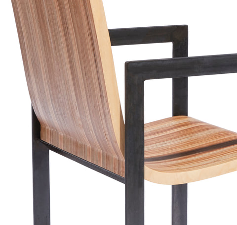detailed view of the Eric Jacoby Design Tectonic Armchair illustrating the natural patinas of the steel frame and the wood seat