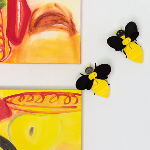 sculptural bees and modern yellow paintings