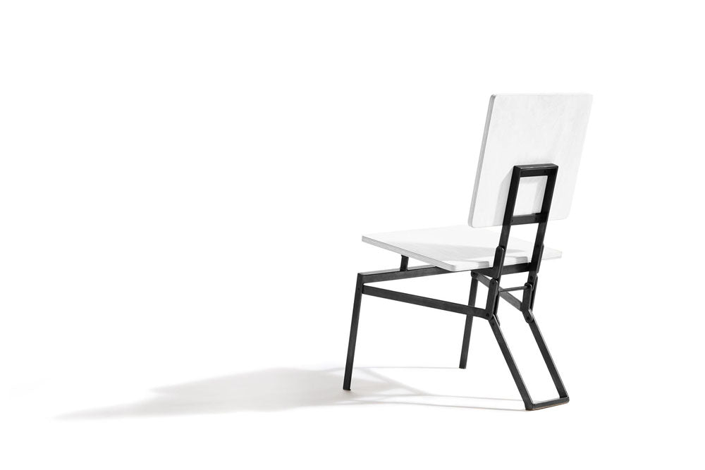 white and black folding chair