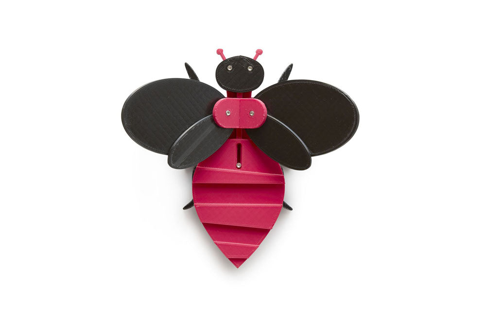 magenta and black toy bee