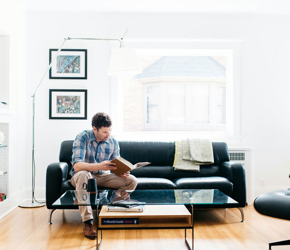 designer sitting near modern coffee table
