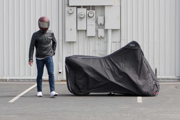 Rider standing next to motorcycle with VUZ Moto motorcycle cover