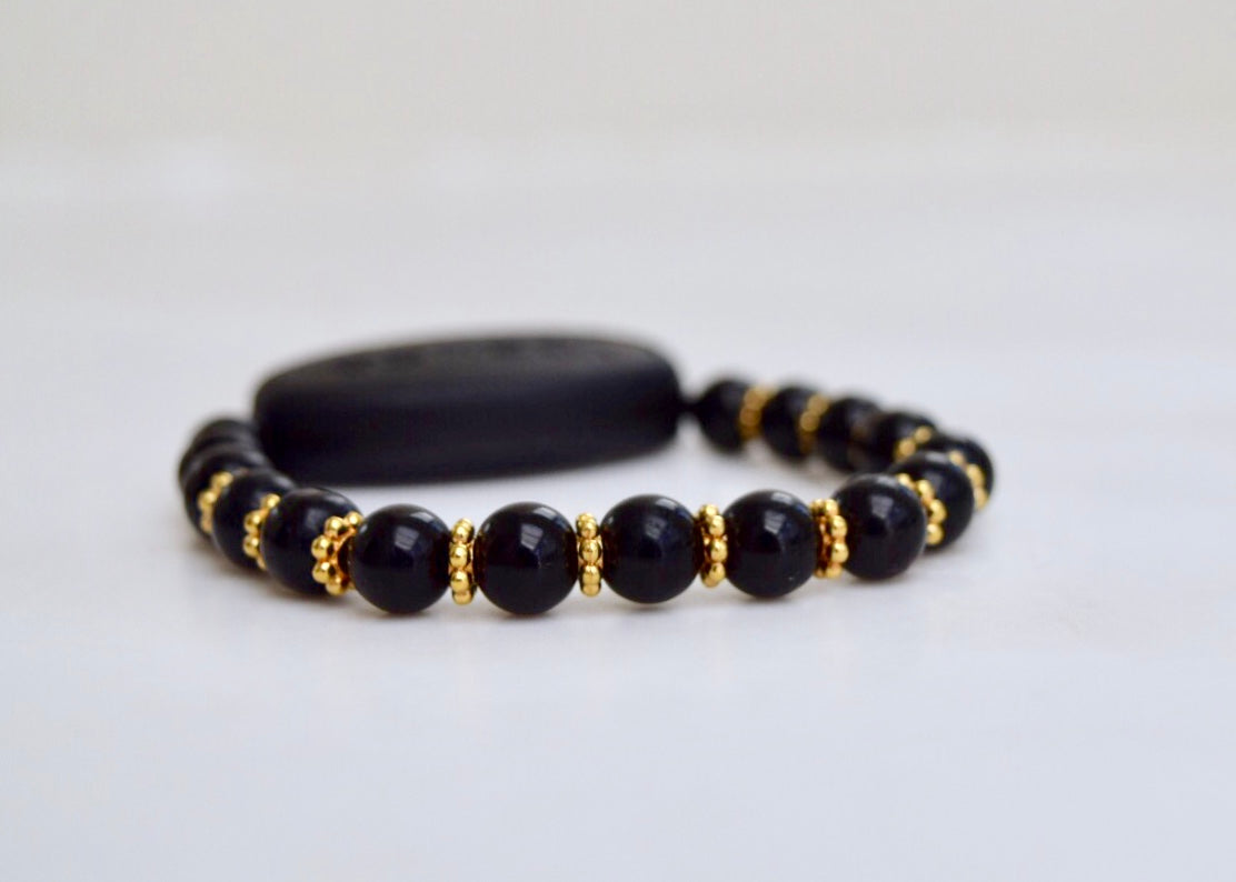 Polished Black Onyx - With Tibet Gold Daisy Spacers