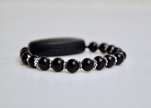 Polished Black Onyx - With Tibet Silver Daisy Spacers