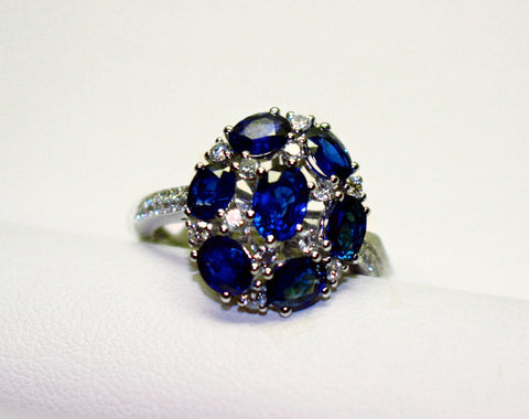 18k White Gold Oval Sapphire and Diamond Cluster Ring - from Holsten Jewelers