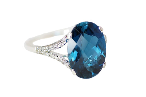 14k White Gold Oval Blue Topaz Diamond Split Shank RIng