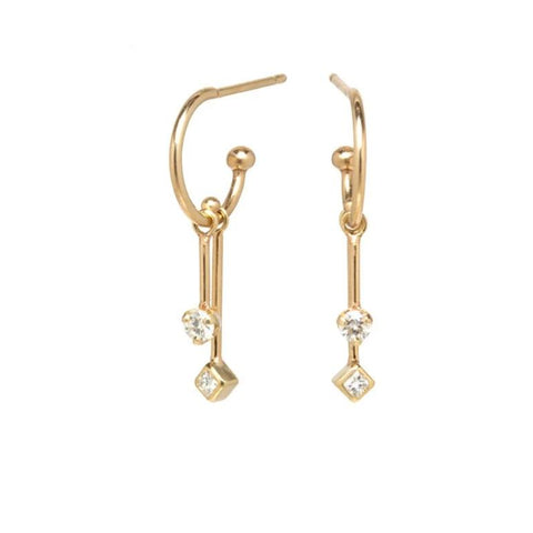 14k Yellow Gold Thin Huggie Hoop Earrings With Dangle Diamonds - from Holsten Jewelers