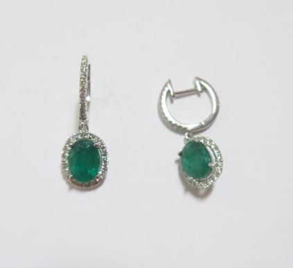 18k White Gold Oval Emerald Earrings In A Diamond Halo On A Diamond Huggie - from Holsten Jewelers