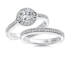 Diamond Halo with Pear Shape Motifs Wedding Set