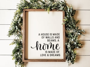 """A house is made of"" Framed Sign"