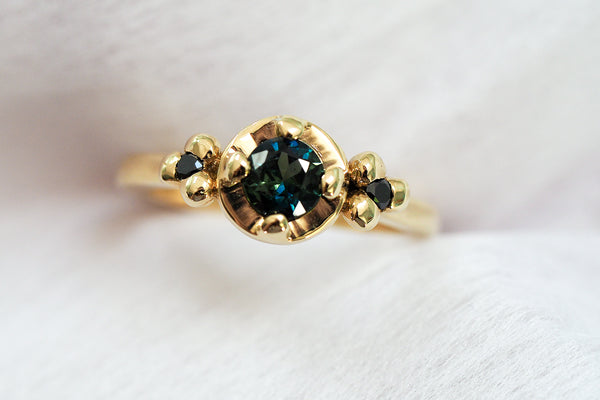 Mijatu Iris Gold, Sapphire and Black Diamond Engagement Ring