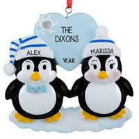 penguin couple ornament on ice