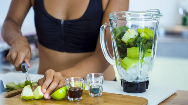 Woman preparing detox smoothie