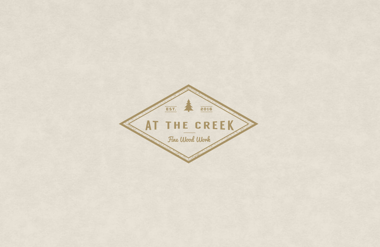 We designed this vintage style custom logo for 'At The creek' furniture made from reclaimed / salvaged wood.