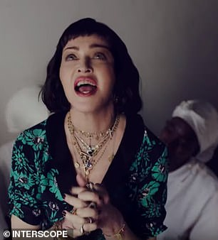 "Madonna as a brunette for a new clip in ""African"" style (video)"