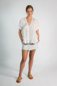 Womens white silk top with bottom frill
