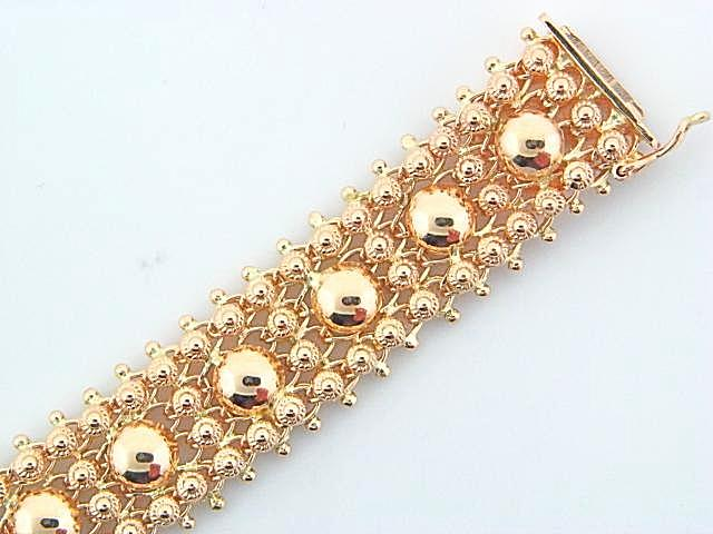 1924 - 19.2k Portuguese Gold 4 Rows, Flowers w/Half Balls Ladies Bracelet - Columbia Jewelers, Fall River, Massachusetts, USA
