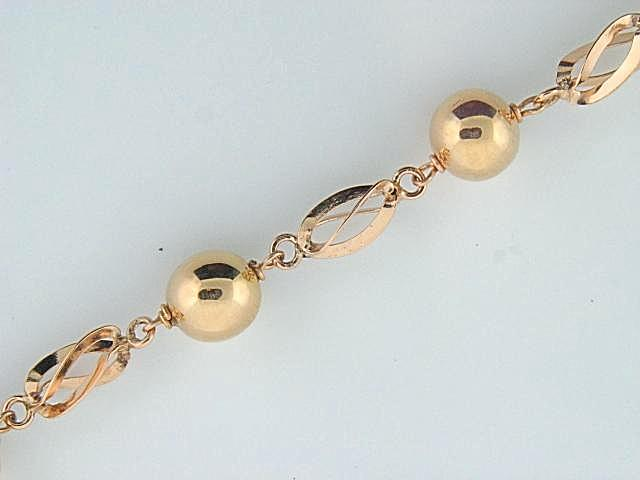 1952 - 19.2K Portuguese Gold Rocas/Bolas Ladies Bracelet - Columbia Jewelers, Fall River, Massachusetts, USA