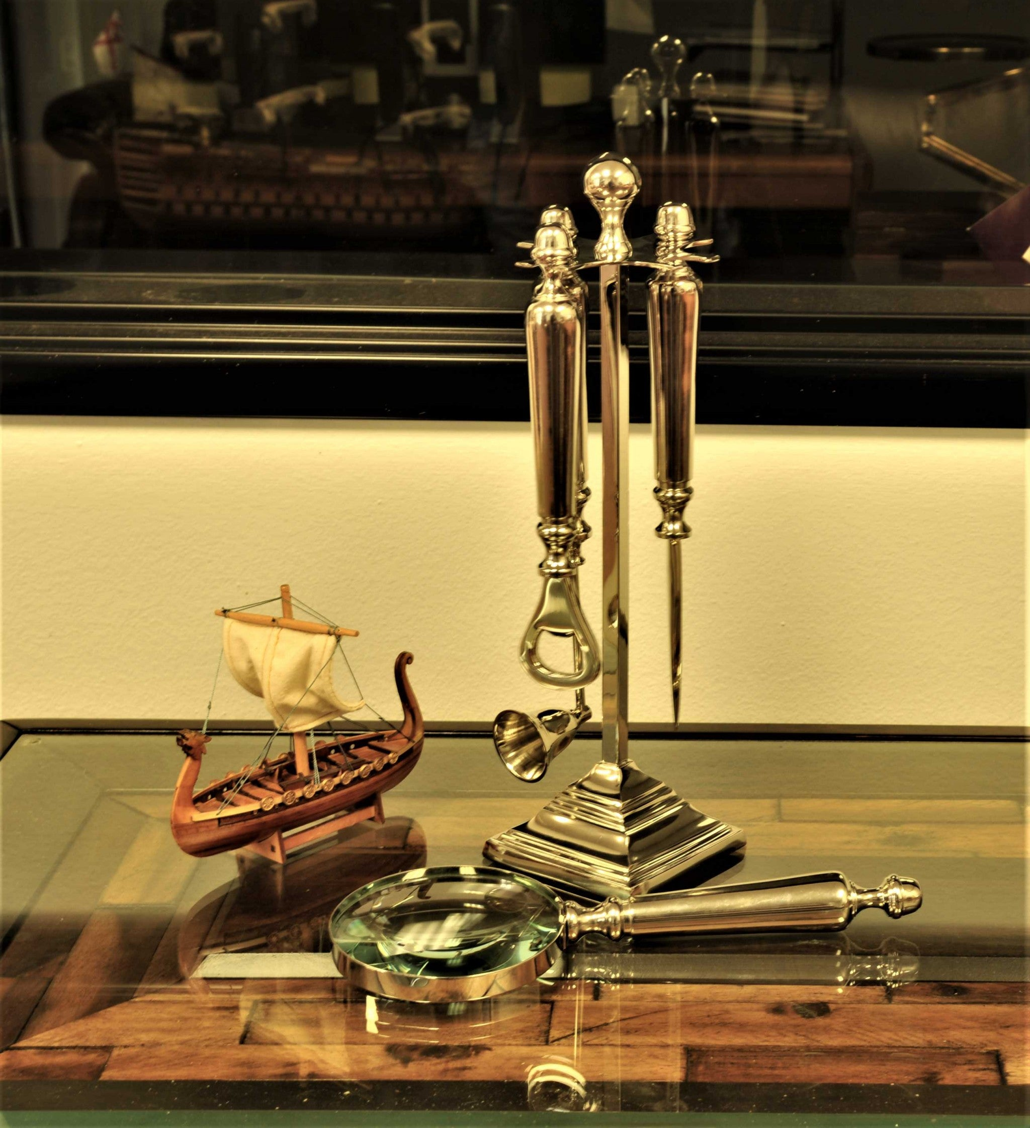 Magnifying glass, Letter opener, Bottle opener, and a Candle snuffer Functional Decor