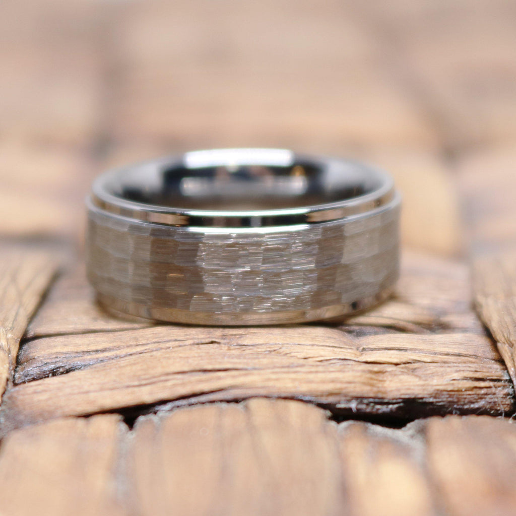 It is an image of Extra Wide 30MM Tungsten Wedding Band for Men with Hammered Center