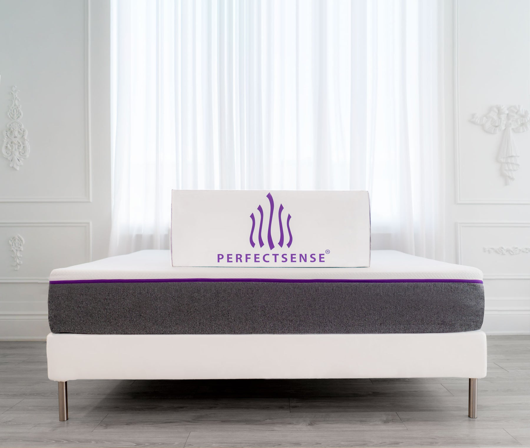 PerfectSense packaging atop mattress and foundation in white room