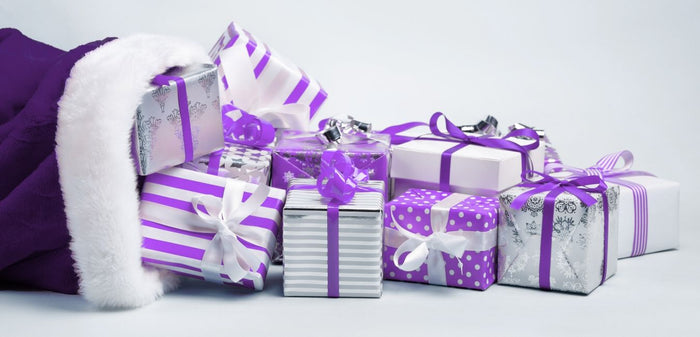 purple sack overflows with gift boxes