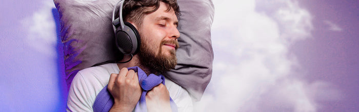 man wears noise cancelling headphones for deeper sleep