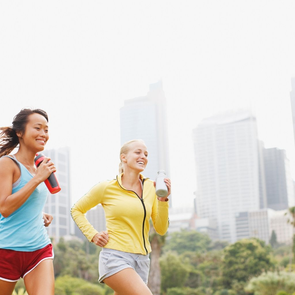 young Asian women and Caucasian women jogging outside