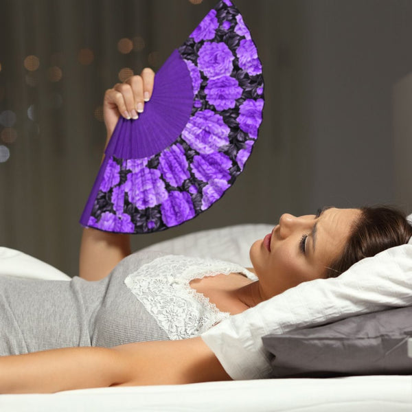 close up of young women fanning herself in bed