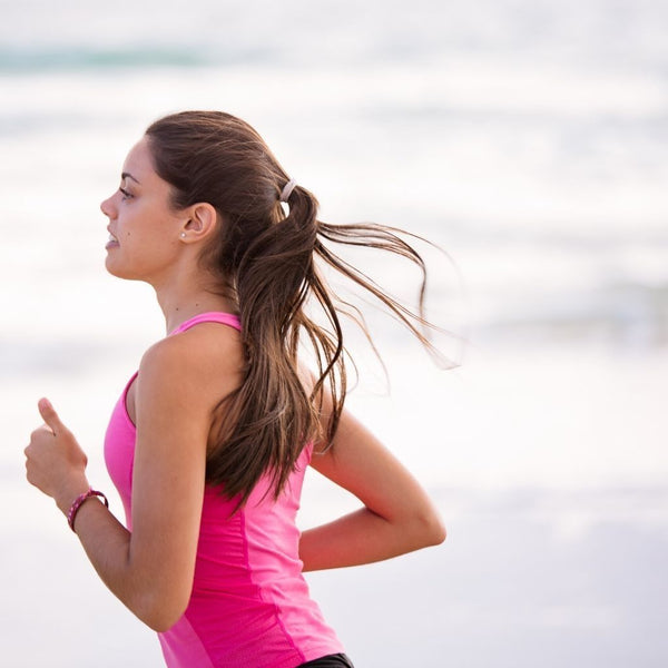 Close up of a young woman jogging