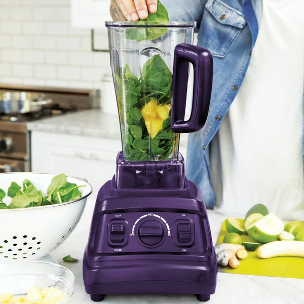 close up of a blender with a man making a smoothie