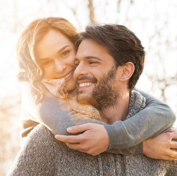 Close up of a young couple smiling outside