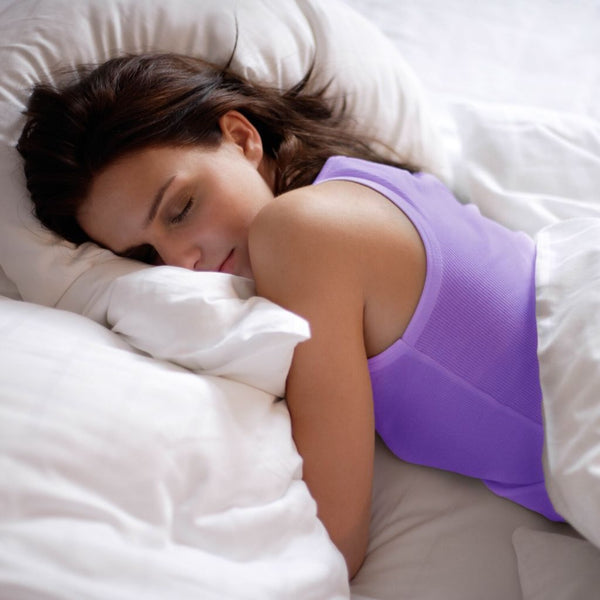 young women dressed in purple sleeping