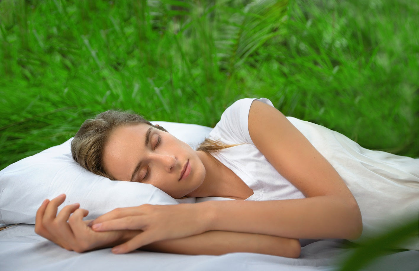 CBD helps woman sleep on white pillow in grass
