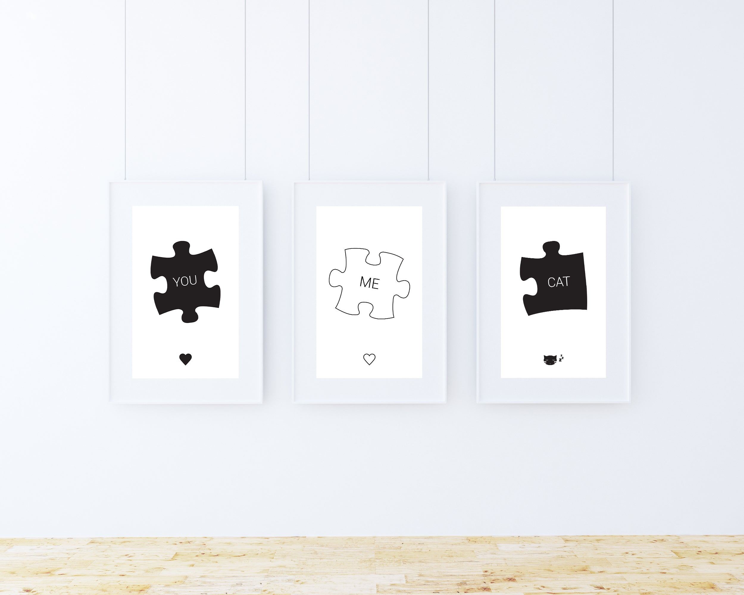 'You' 'Me' 'Cat' wall art prints in frames on a wall